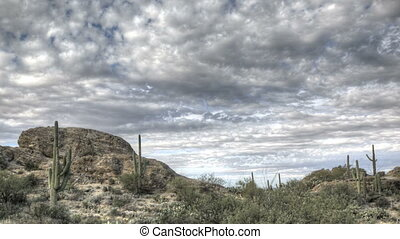 HDR Timelapse Javelina Rocks Saguaro NP Arizona with clouds passing by