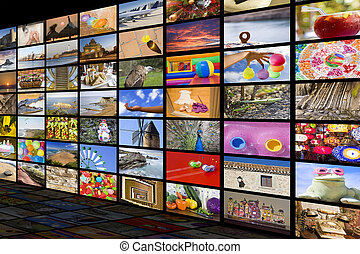 HDTV entertainment concept - Big TV videowall with different...
