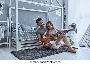 He always believes in her. Young father teaching his little...