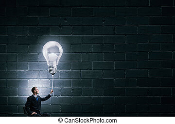 He has good idea - Businessman with bulb on rope ...