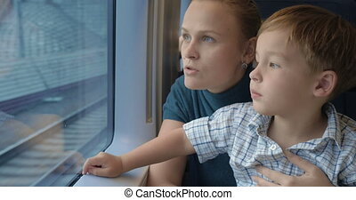 He loves traveling by train with mother