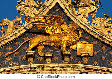 he Venetian lion on a cathedral building on San Marco square. Venice. Italy.