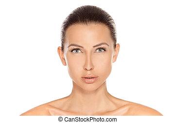 Head and shoulders portrait of a sensual brunette beauty...