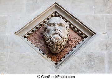 Head Carved in Marble on the Facade of the Baptistery of Siena Cathedral, Italy
