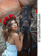 Head horse hugging a cute girl. This occurs at sunset into...