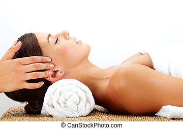 Head massage - A young woman being massaged