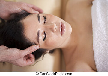 Head massage at a spa