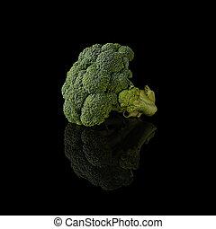 Head of broccoli isolated on black