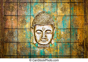 Head of Buddha carved in a wooden door.