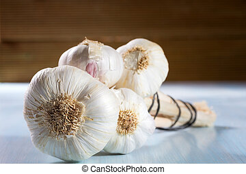 Head of garlic on a wooden background