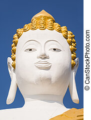 Head of large Buddha statue at Wat Prathat Doi Kam in Chiang...