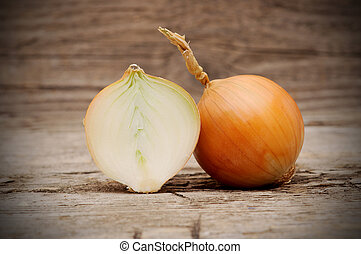 Head of onion on a wood background.