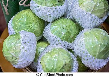 head of the salad in plastic bag. look nice