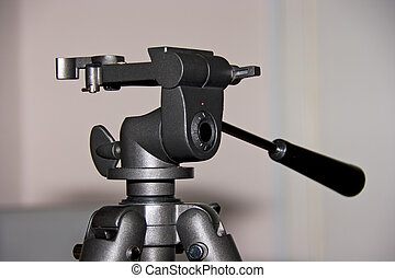 head of tripod - Head of metallic photo tripod on the...