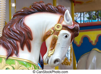 Head of white horse in merry go round at carnival
