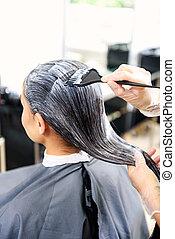 head of woman in barbershop