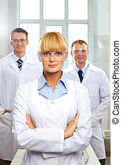 Head physician - Portrait of female doctor standing in front...
