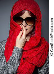 Caucasian or Persian woman modeling modern fashion with head scarf or Hijab