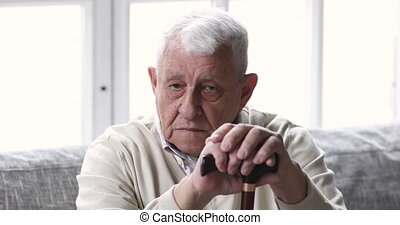 Frustrated old disabled grandfather feeling lonely indoors...