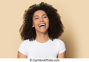 Head shot excited African American girl laughing out loud