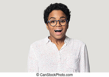 Head shot excited African American woman with open mouth