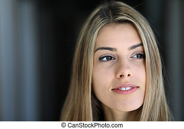 Head Shot of a Beautiful Blond Woman with Brown Eyes