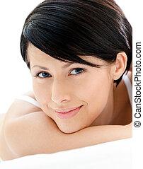 Head shot of a pretty blue eyed woman