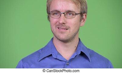Head shot of happy handsome blonde businessman thinking -...