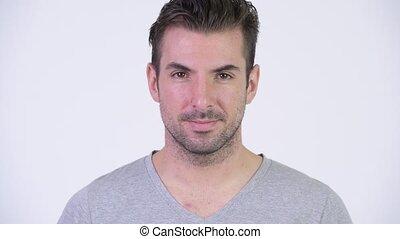 Head shot of young happy Hispanic man smiling