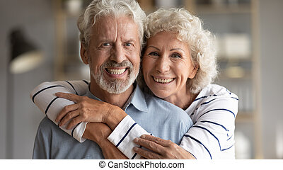 Head shot portrait of happy old retired family couple, ...