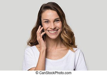 Head shot portrait smiling happy woman talking on phone