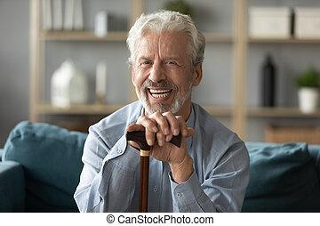 Head shot portrait smiling mature man with walking stick ...
