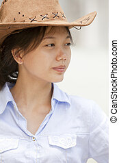 side of asian women with cowboy leather hat