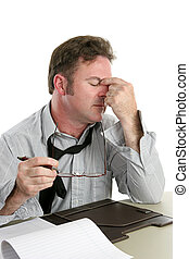 Headache at Work - A businessman at work with a severe...