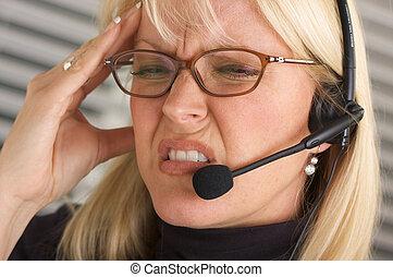 Headache -Businesswoman - Businesswoman with phone headset...
