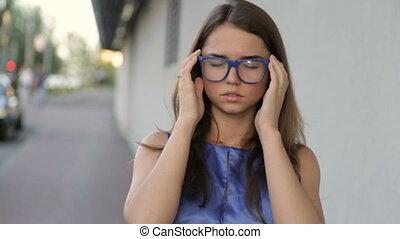 Headache in a girl on the street