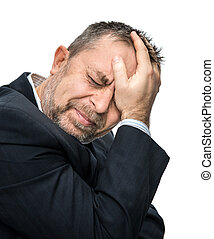 Headache. Portrait of an middle age man with face closed by hands. Isolated on white