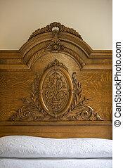 headboard, Rosewood Manor - A decorative wood headboard.