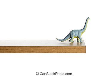 Dinosaur figurine placed on a ledge