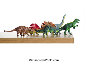 Dinosaurs figurines placed together on a ledge