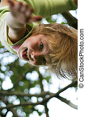 Headfirst - The ridiculous girl hangs on a tree headfirst