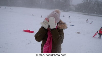 Heading Uphill in the Blizzard - Little girl is struggling...