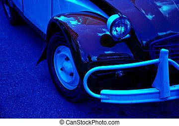Headlamp of blue vintage car, business concept.