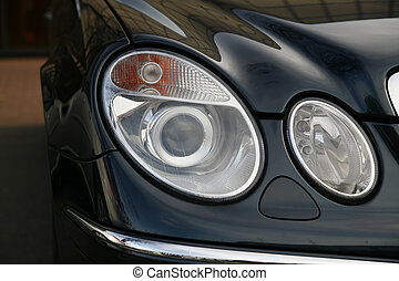 headlamp of expensive car - headlamp of a new car in dealer...