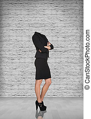 Headless businesswoman in office on the brick wall...