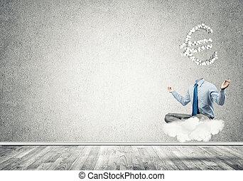 Headless meditating businessman