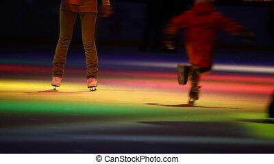headless people skating in city skating rink with dynamic illumination