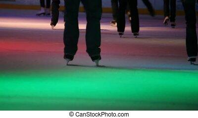 headless people skating in city skating rink with illumination