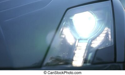 Headlight is turned on - Turned on front light in a modern,...