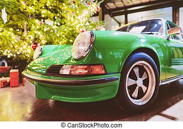 Headlight lamp of green vintage classic car in Berlin, ...